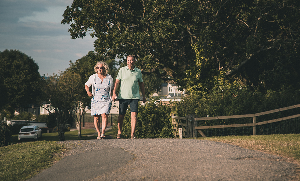 Couple walking at Newlands Holidays, Charmouth, West Dorset
